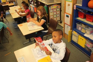 Students read an Operation EDITH brochure to learn how to stay safe.