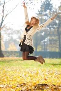Fashion girl enjoying in the park at autumn